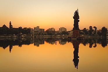 Statue of Shiva rising out of a Lake Sur Sagar in the centre of Vadodara, Gujarat, India, Asia