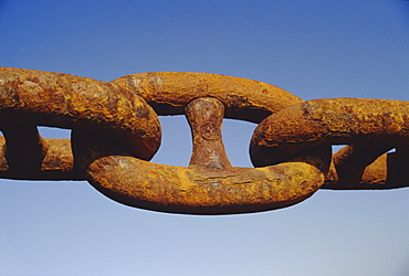 Close-up of a rusty anchor chain of a container ship