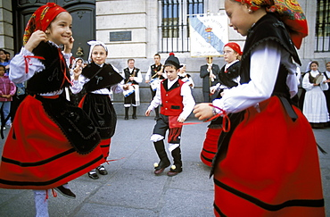 Spanish children in national dress performing outdoors at Plaza de la Puerto del Sol, Centro, Madrid, Spain, Europe