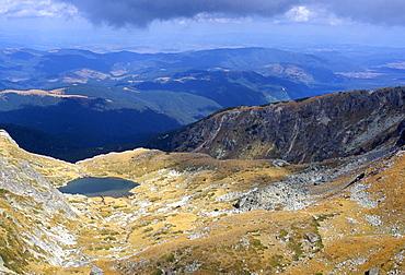Lake in valley below Hajduta peak, 2465m, in Rila Mountains, Rila National Park, Bulgaria, Europe