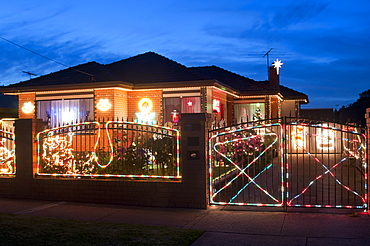 Christmas decoration of Melbourne suburban house at twilight, Altona suburb, Melbourne, Victoria, Australia, Pacific
