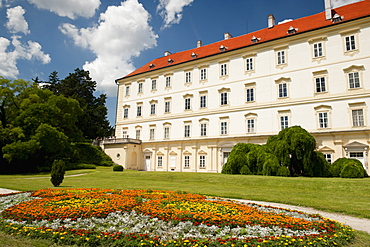 Baroque Valtice Castle with floral decoration in its gardens, Valtice, Brnensko, Czech Republic, Europe