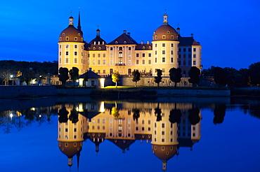 Baroque Moritzburg Castle and reflections in lake at twilight, Moritzburg, Sachsen, Germany, Europe