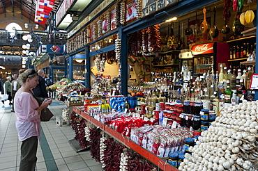Woman shopping inside Nagycsarnok Market, Budapest, Hungary, Europe