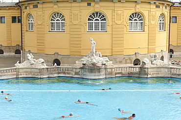 Outdoor pool with men and women at Szechenyi Thermal Baths, Budapest, Hungary, Europe