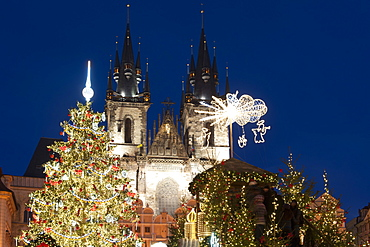 Christmas Tree and decorations in front of Tyn Gothic Church, Old Town Square, UNESCO World Heritage Site, Prague, Czech Republic, Europe