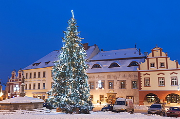 Snow-covered Christmas Tree and Renaissance buildings, Jihocesky, Czech Republic, Europe