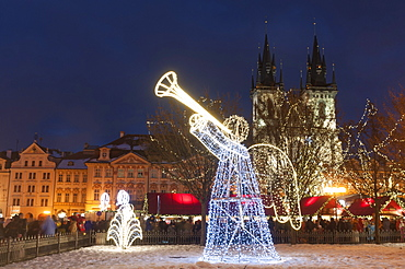 Christmas decorations at Christmas Market and Gothic Tyn Church, Old Town Square, Prague, Czech Republic, Europe