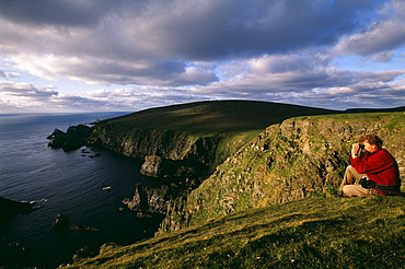 Birdwatching on the cliffs at Hermaness National Nature Reserve in June, Unst, Shetland, Scotland, United Kingdom, Europe