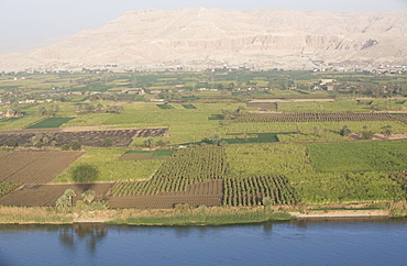 View of the side of the River Nile with the Temple of Deir El Bahari in the background, Thebes, Egypt, North Africa, Africa