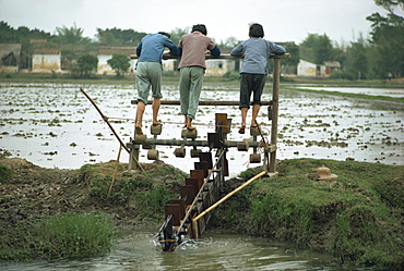 Three women working irrigation mill, near Canton, China, Asia - 74-261