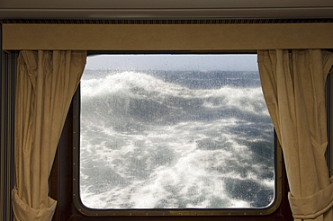 View from cabin on Antarctic Dream navigation on rough seas near Cape Horn, Drake Passage, Antarctic Ocean, Tierra del Fuego, Patagonia, Chile, South America