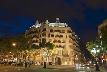 Casa Mila (La Pedrera), by Antoni Gaudi at dusk, Passeig de Gracia, Barcelona, Catalonia, Spain, Europe