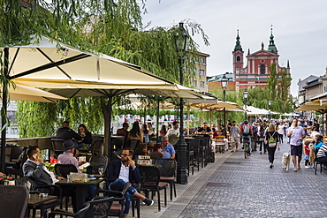 Outdoor cafes along the Ljubljanica river, Ljubljana, Slovenia, Europe