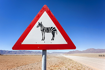 Zebra crossing animal warning sign, Namib Desert, Namibia, Africa