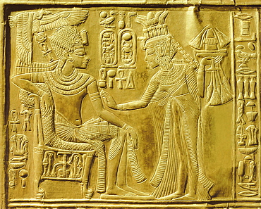Detail of the exterior of the gilt shrine showing the queen bringing unguents and flowers to the king, from the tomb of the pharaoh Tutankhamun, discovered in the Valley of the Kings, Thebes, Egypt, North Africa, Africa