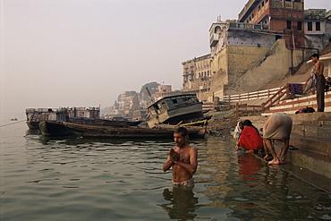 Morning ablutions, Hindu pilgrims bathing in the River Ganges (Ganga), Varanasi (Benares), Uttar Pradesh state, India, Asia