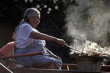 Woman cooking, Xochimilco, Mexico City, Mexico, Central  America, America