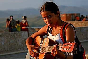 Girl playing guitar, Santiago de Cuba, Cuba island, West Indies, Central America