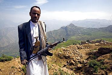 Yemeni man with kalashnikov, Al Tawila, Yemen, Middle East