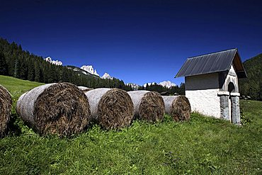 Hayballs and aedicula, Fassa Valley, Trentino, Italy