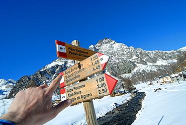 Path sign in Crampiolo, Alpe Devero, Ossola Valley, Verbania province, Piedmont, Italy