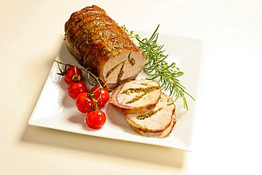 Lonza di maiale farcita al rosmarino, rosemary stuffed loin of pork roasted with grilled tomato, Italy, Europe