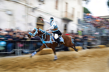 Horseman gallops to pierce the star with his sword, Sartiglia feast, Oristano, Sardinia, Italy, Europe