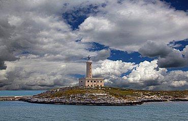 Lighthouse on the rock of Santa Eufemia, Gargano Promontory, Gargano National Park, Puglia, Italy