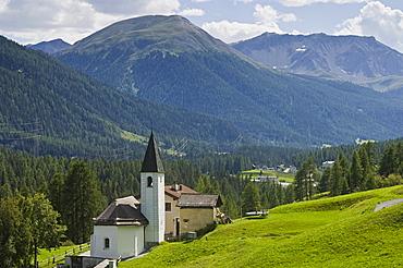 village partial view and church, brail, switzerland