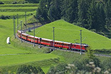 train near village, zernez, switzerland