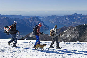 people with snowshoes, pora mountain, italy