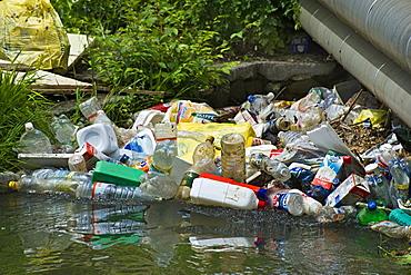 rubbish along the nesa stream, nese, italy
