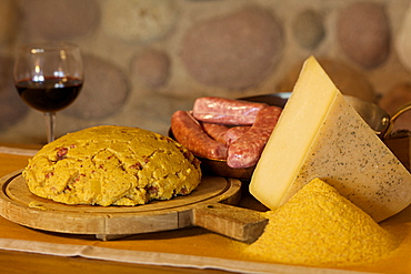 Polenta carbonera and his ingredients vith Spressa cheese, sausage and flour, Giudicarie valley, Trentino, Italy, Europe