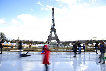 Eiffel tower and ice skating at Christmas markets, Paris, France, Europe