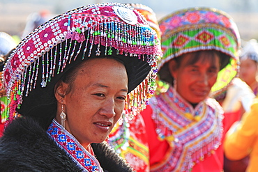 Chinese woman in traditional Miao attire during the Heqing Qifeng Pear Flower festival, China