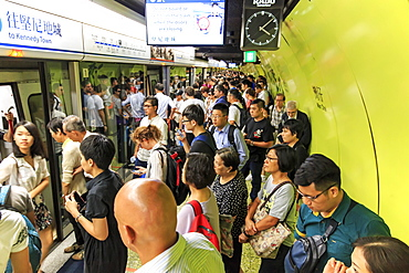 Commuters waiting for a train in the MTR Wan Chai in Hong Kong, China