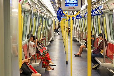 Commuters inside a train of the MTR of Hong Kong, the most popular mean of transportation in the city, China