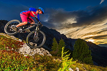 Mountain bikers at sunset, Carezza, Latemar, Trentino-AltoAdige, Dolomites, Italy, Europe