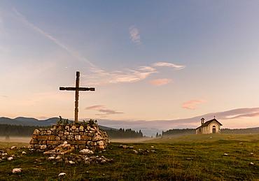 Wooden Cross, Saint Lorenzo church in the mist, Plains of Marcesina, Altopiano of Asiago, Veneto, Italy, Europe
