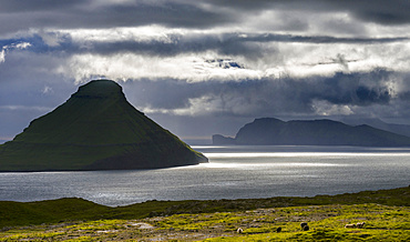 Koltur island at sunset, the island Vagar in the background The island Streymoy, one of the two large islands of the Faroe Islands  in the North Atlantic.  Europe, Northern Europe, Denmark, Faroe Islands