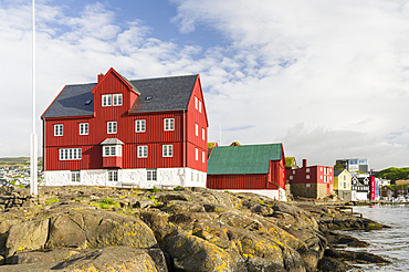 Peninsula Tinganes with old town and the red houses of the government district. Torshavn (Thorshavn) the capital of the Faroe Islands on the island of Streymoy in the North Atlantic, Denmark, Northern Europe