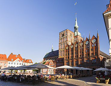 The  Alte Markt (old market) with the iconic town hall and the church St. Nikolei (Saint Nicholas). The Hanseatic City Stralsund. The old town is listed as UNESCO World Heritage. Europe, Germany, West-Pomerania, June