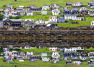 Small town Midvagur on the island of  Vagar, part of the Faroe Islands.   Europe, Northern Europe, Denmark, Faroe Islands