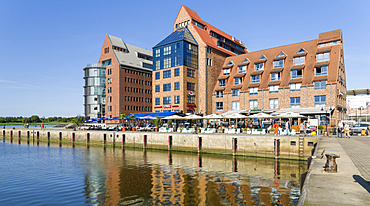 Harbour at the Unterwarnow, dockyard development at the peninsula Silohalbinsel.  The hanseatic city of Rostock at the coast of the german baltic sea.  Europe,Germany, Mecklenburg-Western Pomerania, June