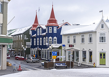 Akureyri during winter, Hafnarstraeti in the town center. The traffic calmed street is kept snow and ice free by a heating system powered by geothermal energy. Akureyri  is Icelands second largest city, second only the Reykjavik area. europe, northern europe, iceland,  March