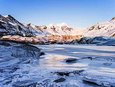 Svinafellsjoekull glacier in Vatnajoekull NP during Winter, view of Mt. Hrutsfjall during sunset. europe, northern europe, scandinavia, iceland,  February