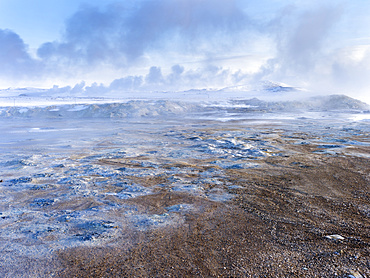 Geothermal area Hveraroend near lake  Myvatn and the ring road during winter with mud pools , fumaroles and solfataras.  europe, northern europe, scandinavia, iceland,  February