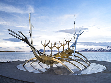 Solfar, a landmark of  Reykjavik. Solfar  icelandic for Sun Voyager is a sculture made of stainless steel in the harbour of Reykjavik made be the artist Jon Gunnar Arnason.  europe, northern europe, iceland,  February