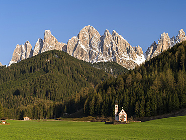 The peaks of the GEisler mountain range in valley Villnoess.  The church Sankt Johann in Ranui (St. John in Ranui). The Geisler mountain range is one of the most famous areas for hikers and climbers in the Dolomites. This part of the dolomites is part of the nature park Puez-Geisler and belongs to the UNESCO world heritage Dolomites.  Europe, Central Europe, Italy, South Tyrol, April 2012